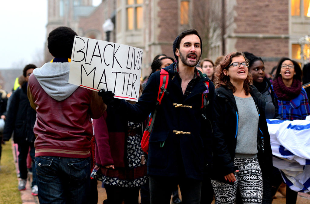 Cameron Kinker leads a campus protest in December, 2014. During his four years at Washington University Kinker has advocated for racial equality and LGBT rights. James Byard / WUSTL Photos